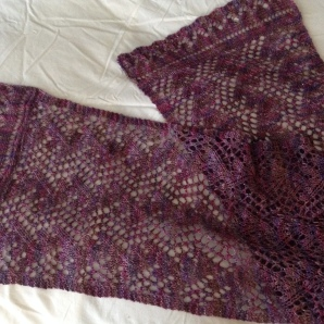 """Scarf/shawl: Elaborated Print O' the Wave pattern by Eunny Jang, from her Craftsy class """"Lace Knitting: Basics and Beyond"""". Yarn is Interlacements Irish Jig [African Violets]."""
